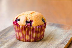 A tasty cherry lemon muffin. A single freshly baked cherry lemon muffin on a wooden table Stock Photography