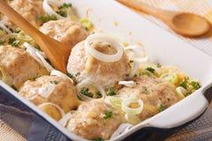 Tasty chicken balls in cheese cream sauce close-up. horizontal Stock Photo