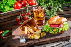 Tasty chicken burger with cold drink and fries Royalty Free Stock Photo