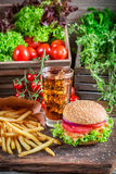 Tasty chicken burger with fries and cold drink Stock Photography