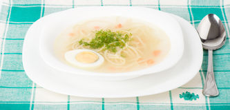 Tasty chicken clear soup with egg Royalty Free Stock Photo