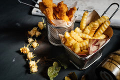 Tasty Chicken fingers and fries, food details. Fried chicken as delicious dinner Royalty Free Stock Image
