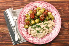 Tasty chicken meat under creamy sauce with brussels sprouts garn Royalty Free Stock Image