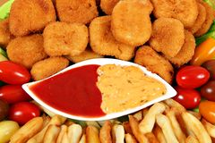 Tasty chicken nuggets and french fries stock photos