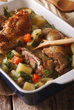 Tasty chicken stew with potatoes and carrots in a dish close-up. Royalty Free Stock Image
