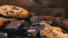Tasty chip cake cookies with chocolate pieces shallow and Pieces of milk and dark chocolate stock video footage