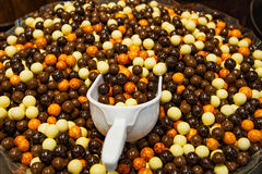 Tasty chocolate balls in candy store stock image
