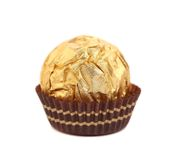 Tasty chocolate bonbon in golden foil. Stock Photos