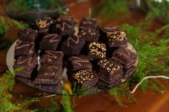 Tasty chocolate brownies, portions with arequipe and peanuts. Arranged for the guests at the reception royalty free stock photography