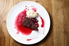 Chocolate brownie with raspberry sauce and ice cream royalty free stock photo