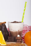 Tasty chocolate cake with orange on a wooden base and hot chocol Royalty Free Stock Photography