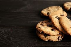Free Tasty Chocolate Chip Cookies On Wooden Table. Stock Image - 132764371
