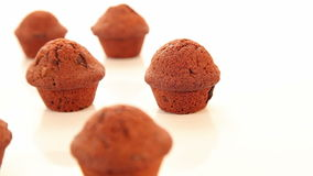 Tasty chocolate cupcakes, muffins on white background stock footage