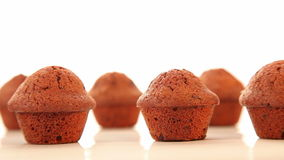 Tasty chocolate cupcakes, muffins on white background stock video footage