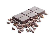 Tasty chocolate curls and bar. Royalty Free Stock Images