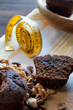 Muffins and measuring tape Royalty Free Stock Photos