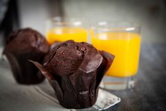 Tasty chocolate muffin with walnuts. stock images