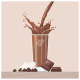 Tasty chocolate pouring into a glass Stock Photography