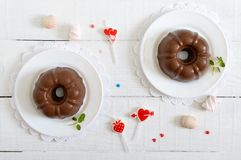 Tasty chocolate pudding on plates on a white wooden background. Light low-calorie dessert for breakfast. Top view, flat lay royalty free stock photos