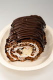Tasty Chocolate roll with milky cream Royalty Free Stock Photography