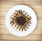 Tasty chocolate rolls and gingerbread cookie on the white plate Stock Photo