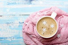 Tasty Christmas coffee or cocoa on blue wooden background and pink tablecloth. Copy space stock image