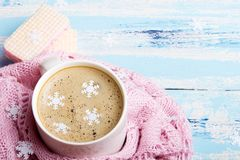 Tasty Christmas coffee or cocoa and sweet cookies on blue wooden background. And pink tablecloth. Copy space Stock Images