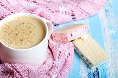 Coffee or cocoa and sweet cookies on blue wooden background. Tasty Christmas coffee or cocoa and sweet cookies on blue wooden background and pink tablecloth Royalty Free Stock Images