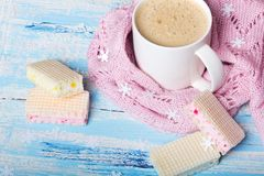 Coffee or cocoa and sweet cookies on blue wooden background. Tasty Christmas coffee or cocoa and sweet cookies on blue wooden background and pink tablecloth Royalty Free Stock Photos