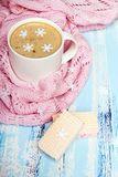 Coffee or cocoa and sweet cookies on blue wooden background. Tasty Christmas coffee or cocoa and sweet cookies on blue wooden background and pink tablecloth Royalty Free Stock Photo