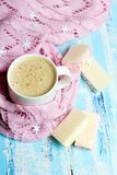 Tasty Christmas coffee or cocoa and sweet cookies on blue wooden background. And pink tablecloth. Copy space Stock Photos