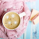 Tasty Christmas coffee or cocoa and sweet cookies on blue wooden background. And pink tablecloth. Copy space Royalty Free Stock Images