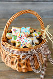 Tasty Christmas cookies in a wicker basket Stock Photos