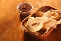 Tasty Churro Recipe with Choco Dip Sauce. Close up Tasty Churro Recipe with Chocolate Dip Sauce on Side, Placed on Wooden Table Royalty Free Stock Image