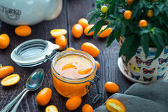 Tasty Citrus Fruits Jam in Small Rustic Glass Jar stock photo