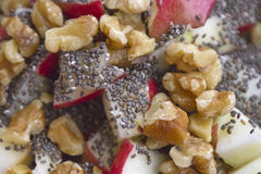Tasty Close Up of Raw Apple, Walnuts and Chia Seeds Stock Photos