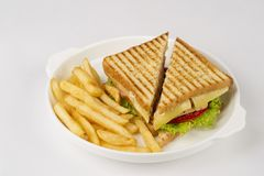 Tasty club sandwich. Delicious sandwich and fried potatoes Stock Image