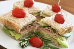 Tasty club sandwich on wholewheat bread Stock Photos