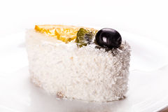 Tasty coconut cake slice close-up Royalty Free Stock Image