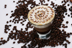 Tasty coffee cocktail. Glass of coffee cocktail on the table with coffee beans, close-up view Royalty Free Stock Photography