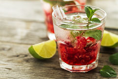 Tasty cold fresh drink lemonade with raspberry, mint, ice and li Royalty Free Stock Image