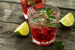 Tasty cold fresh drink lemonade with raspberry, mint, ice and li Royalty Free Stock Photos