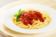 Tasty colorful appetizing cooked spaghetti italian pasta with to Royalty Free Stock Image