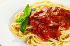 Tasty colorful appetizing cooked spaghetti italian pasta with to Royalty Free Stock Photo
