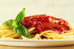 Tasty colorful appetizing cooked spaghetti italian pasta with to Royalty Free Stock Photos