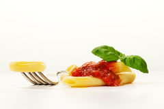 Tasty colorful appetizing cooked spaghetti italian pasta with to Stock Photography