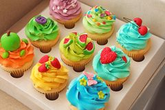 Tasty colorful cupcakes in open   box. Tasty colorful cupcakes in open paper box Stock Photo