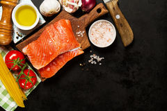 Tasty colorful Food Background with fresh Raw Fish Salmon and Co Stock Images