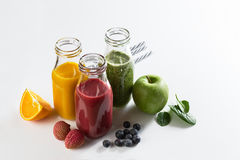 Tasty colorful fresh homemade smoothies in glass jars on bright royalty free stock photography