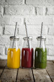 Tasty colorful fresh homemade smoothies in glass jars on wooden Stock Photography